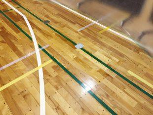 体育館バドミントン用金具交換に伴うフローリング部分張替え及びコートライン復旧