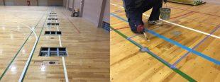 低鉄棒用の床金具を設置施工中